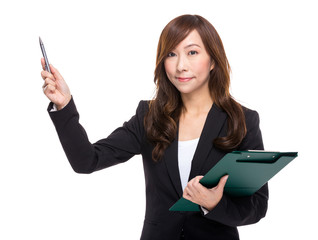 Businesswoman with file pad and pen indicate something