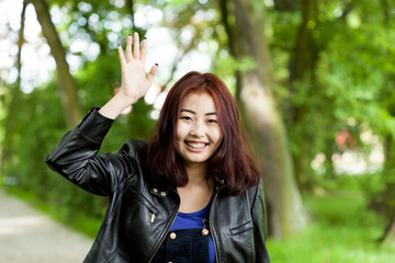 Girl waving her hand