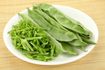Sliced Hyacinth bean in white plate.