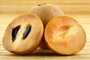 Sapodilla plum, (Manilkara zapota (L.) P. Royen).