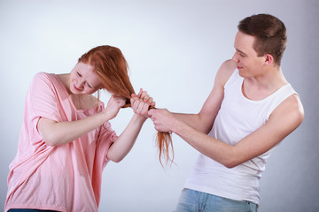 Boy pulling girl hair