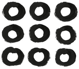 Collection of black round brush strokes.