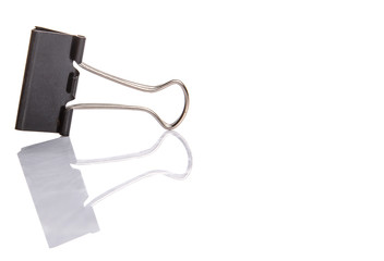 Binder clip over white background