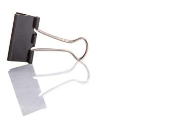 Binder clip over white background