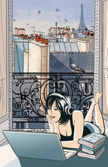 Young woman entertaining with computer in Paris