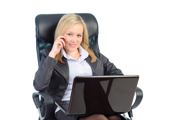 Woman sitting on chair with laptop in hand.