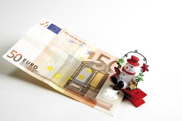 Schneemann auf Euro-Noten