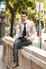Young modern businessman making selfie