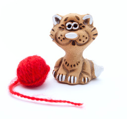 The kitty statuette near the yarn