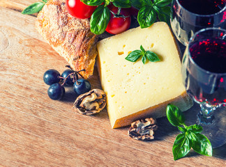 cheese with red wine and walnuts. food and beverages
