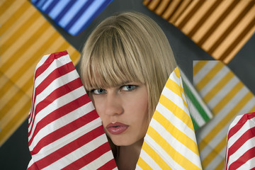 Woman with color stripes background, looking in