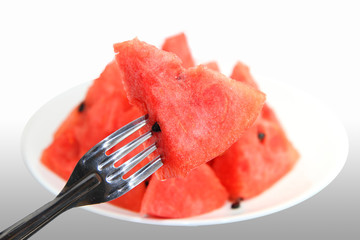 Red watermelon impaled on a fork