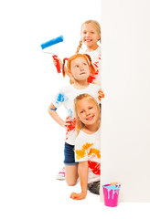 Three funny kids in painted shirts
