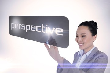 Businesswoman pointing to word perspective