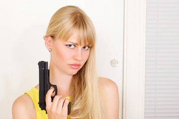 Armed girl at door about to break and enter