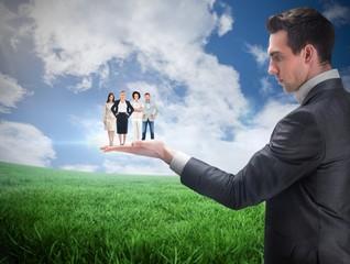 Composite image of businessman holding business team