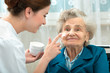 Elderly woman is assisted by nurse at home - 67773459