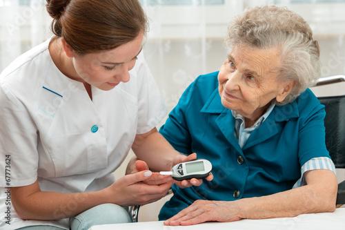 Leinwandbild Motiv Measuring blood glucose level