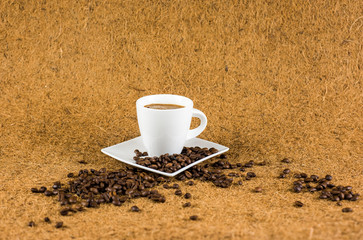Coffe cup on brown background texture