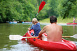 Father and son kayaking on the river