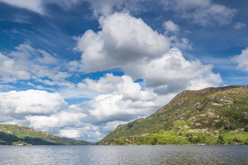 Clouds over lake Ullswater in the Lake District, UK