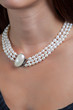 Woman with pearl necklace on her neck - 67775057