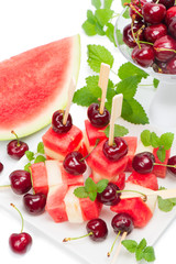 Colorful kebabs made with  melon, watermelon and cherries