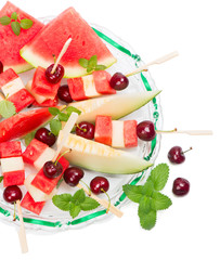 Top view of fresh fruits salad of melon, watermelon and cherries