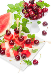 fresh fruits salad of melon, watermelon and cherries  decorated