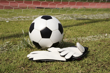 Gloves and soccer ball