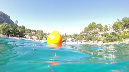 Buoy in the sea near the beach, Palaiokastritsa in Corfu, Greece
