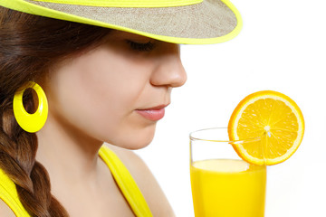 Portrait of a girl with orange juice on white background