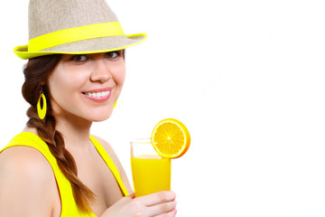 Portrait of a smiling girl with orange juice on white background