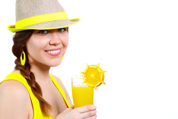 Portrait of a beautiful girl in a hat with orange juice