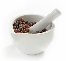 Aromatic black peppers in a mortar and pestle