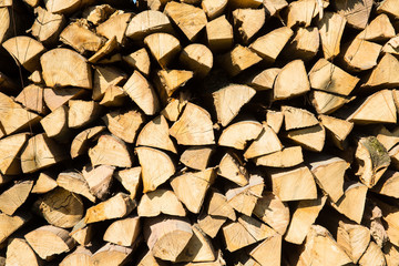 Pile of chopped firewood prepared for winter