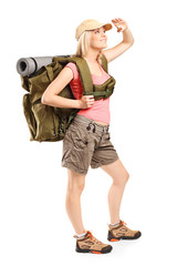 Full length portrait of a female hiker looking up