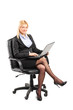 Businesswoman working on laptop seated on chair