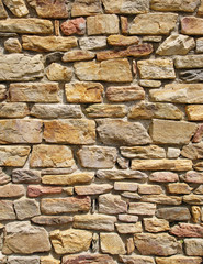 Colorful stone wall closeup in sunny day