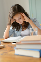 Student teenage girl concentrate reading book home