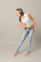 Singing girl with headphones enjoy dance