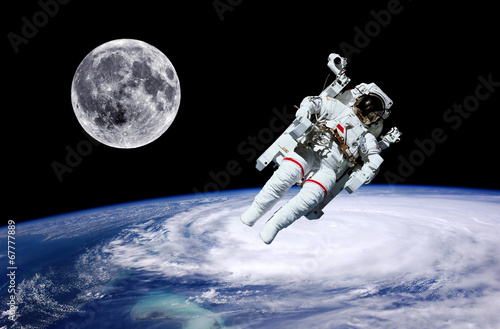 Leinwandbild Motiv Astronaut Earth Moon Space