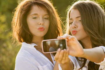 Students taking a self portrait with smart phone