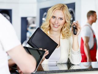 Female customer gets her car key