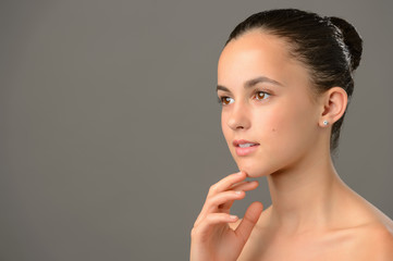 Thoughtful teenage girl beauty skin care