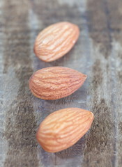 close - up almond seeds  on wood background