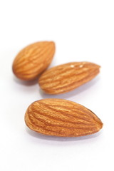 close - up almond seeds  on white