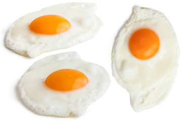 Collage of fried eggs on white. Different angles.