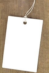 Close - up blank price tag on wood background