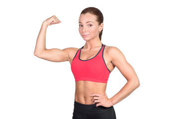Sportive young woman showing muscles on hands